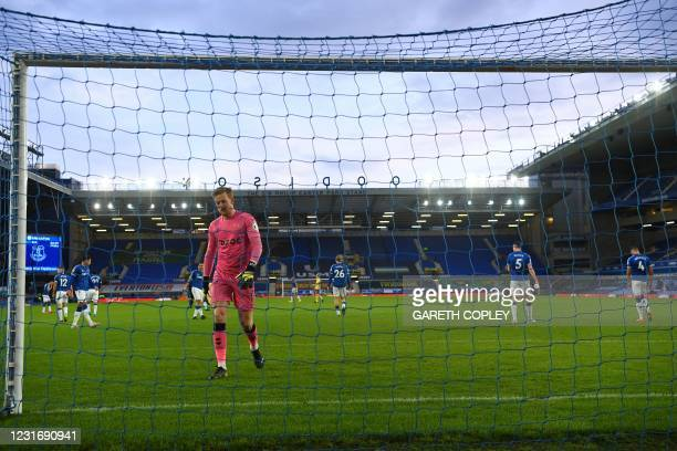 Everton's English goalkeeper Jordan Pickford reacts after conceeding the second goal during the English Premier League football match between Everton...