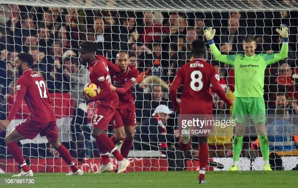 Everton's English goalkeeper Jordan Pickford reacts after his late mistake allows Liverpool's Belgian striker Divock Origi to score the winner during...