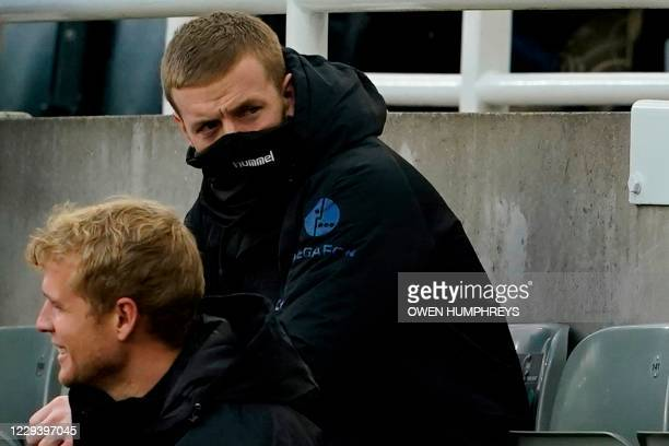 Everton's English goalkeeper Jordan Pickford sits on the substitutes bench during the English Premier League football match between Newcastle United...