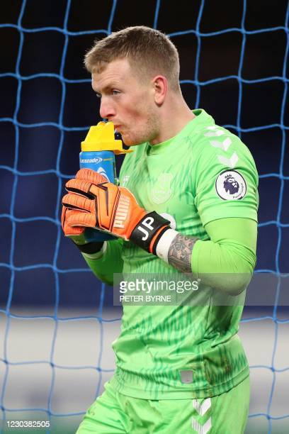 Everton's English goalkeeper Jordan Pickford takes a drink during the English Premier League football match between Everton and West Ham United at...