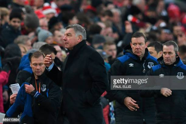 Everton's English manager Sam Allardyce and his team leave the dugout at halftime during the English Premier League football match between Liverpool...