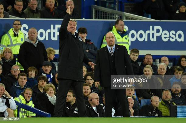 Everton's English manager Sam Allardyce and Newcastle United's Spanish manager Rafael Benitez watch the play from the touchline during the English...