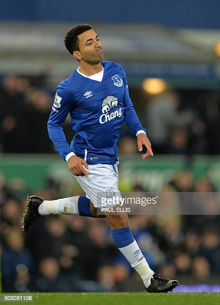Everton's English midfielder Aaron Lennon celebrates after scoring the opening goal of the English Premier League football match between Everton and...
