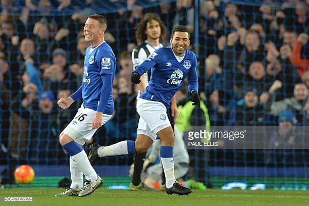 Everton's English midfielder Aaron Lennon celebrates scoring the opening goal with Everton's Scottishborn Irish midfielder James McCarthy during the...