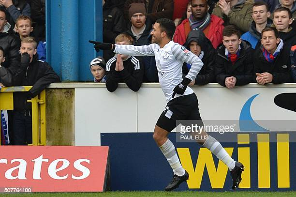 Everton's English midfielder Aaron Lennon celebrates scoring their second goal during the English FA Cup fourth round football match between Carlisle...