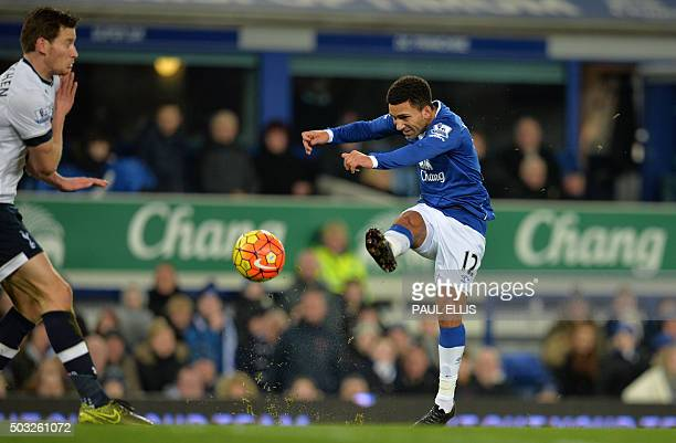 Everton's English midfielder Aaron Lennon shoots to score the opening goal of the English Premier League football match between Everton and Tottenham...