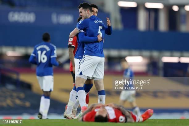 Everton's English midfielder Ben Godfrey and Everton's English defender Michael Keane celebrate after the English Premier League football match...