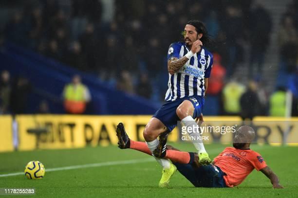 Everton's English midfielder Fabian Delph tackles Everton's Portuguese midfielder André Gomes during the English Premier League football match...