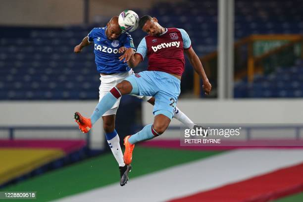 Everton's English midfielder Fabian Delph vies for the ball against West Ham United's French striker Sebastien Haller during the English League Cup...