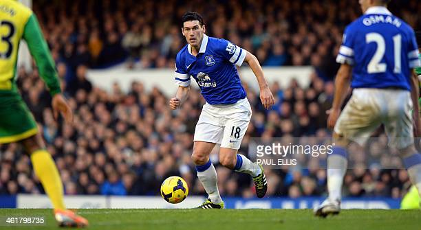 Everton's English midfielder Gareth Barry runs with the ball during the English Premier League football match between Everton and Norwich City at...