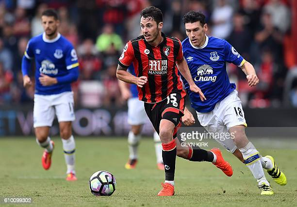 Everton's English midfielder Gareth Barry vies wirh Bournemouth's English defender Adam Smith during the English Premier League football match...