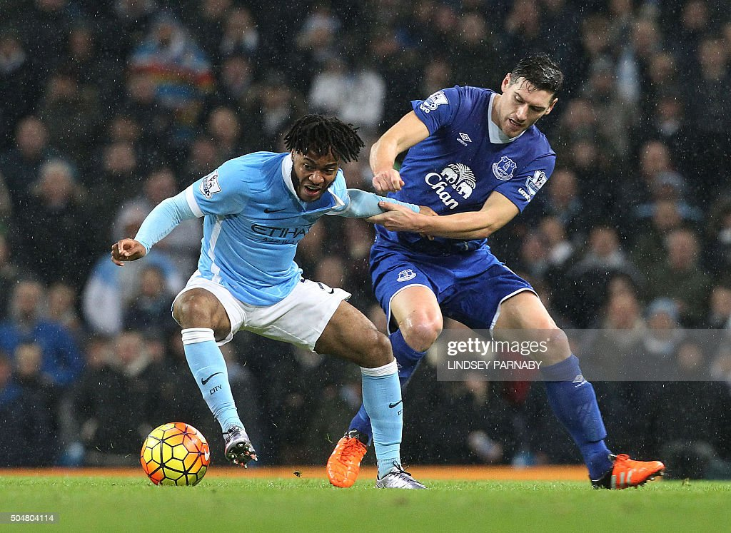 Everton's English midfielder Gareth Barry (R) vies with Manchester City['s English midfielder Raheem Sterling during the English Premier League football match between Manchester City and Everton at the Etihad stadium in Manchester, north west England on January 13, 2016. OR 'LIVE' SERVICES. ONLINE