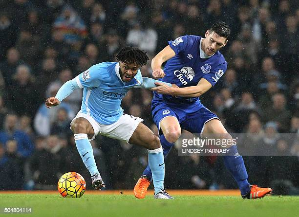 Everton's English midfielder Gareth Barry vies with Manchester City['s English midfielder Raheem Sterling during the English Premier League football...