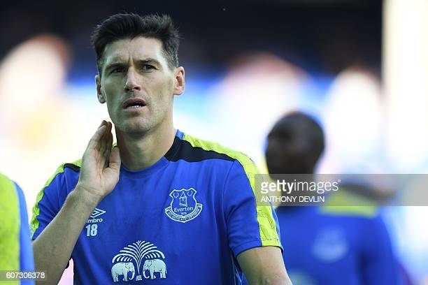 Everton's English midfielder Gareth Barry warms up before the English Premier League football match between Everton and Middlesbrough at Goodison...