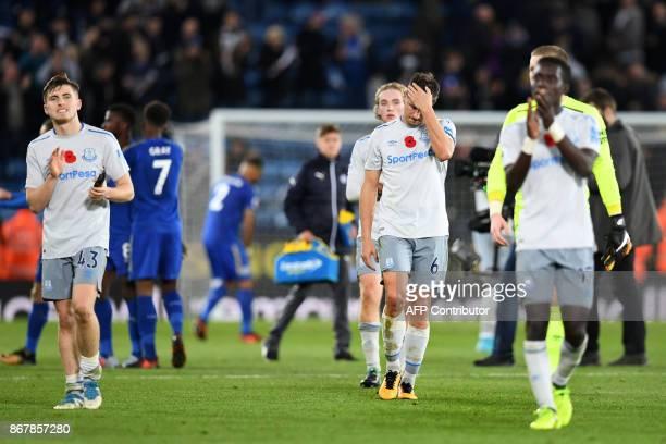 Everton's English midfielder Jonjoe Kenny and Everton's English defender Phil Jagielka react after the English Premier League football match between...