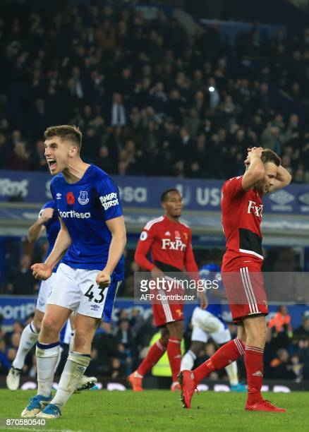 Everton's English midfielder Jonjoe Kenny celebrates after Watford's English mifielder Tom Cleverley fails to score from the penalty spot in the...
