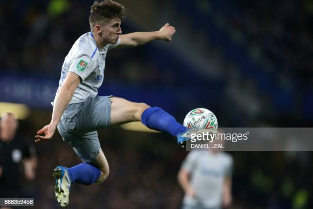 Everton's English midfielder Jonjoe Kenny controls the ball during the English League Cup fourth round football match between Chelsea and Everton at...