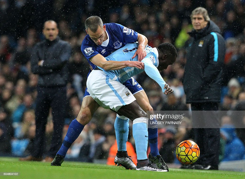 Everton's English midfielder Leon Osman (L) vies with Manchester City's French defender Bacary Sagna during the English Premier League football match between Manchester City and Everton at the Etihad stadium in Manchester, north west England on January 13, 2016. OR 'LIVE' SERVICES. ONLINE