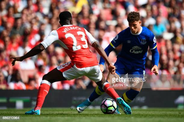 Everton's English midfielder Ross Barkley takes on Arsenal's English striker Danny Welbeck during the English Premier League football match between...