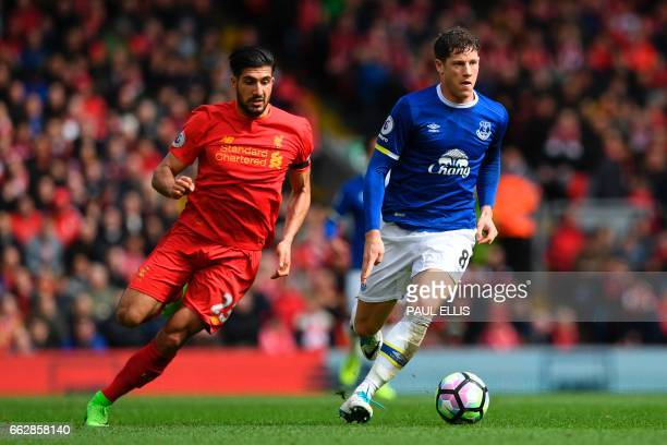 Everton's English midfielder Ross Barkley vies with Liverpool's German midfielder Emre Can during the English Premier League football match between...