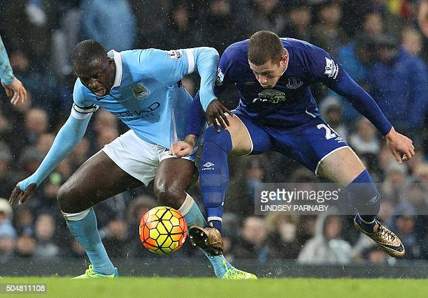 Everton's English midfielder Ross Barkley vies with Manchester City's Ivorian midfielder Yaya Toure during the English Premier League football match...