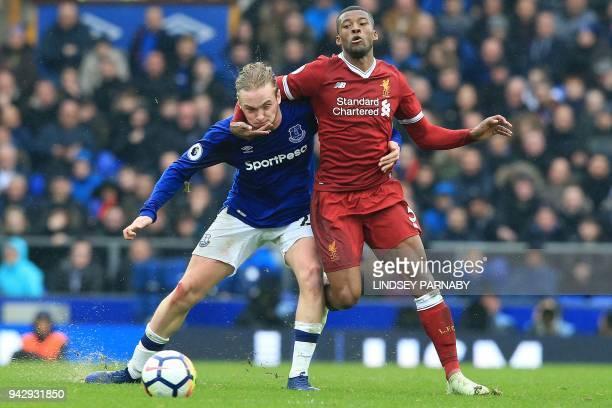Everton's English midfielder Tom Davies battles with Liverpool's Dutch midfielder Georginio Wijnaldum during the English Premier League football...