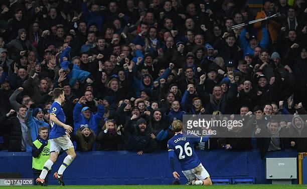 Everton's English midfielder Tom Davies celebrates after scoring their third goal during the English Premier League football match between Everton...