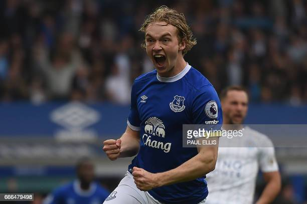 Everton's English midfielder Tom Davies celebrates scoring his team's first goal during the English Premier League football match between Everton and...