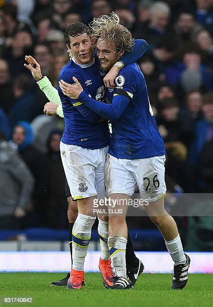 Everton's English midfielder Tom Davies celebrates with Everton's English midfielder Ross Barkley after scoring their third goal during the English...