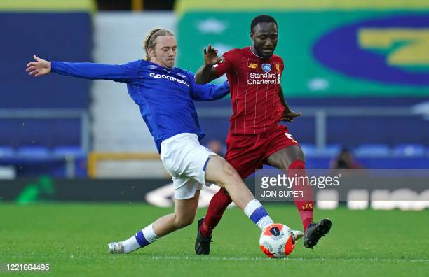 Everton's English midfielder Tom Davies challenges Liverpool's Guinean midfielder Naby Keita during the English Premier League football match between...