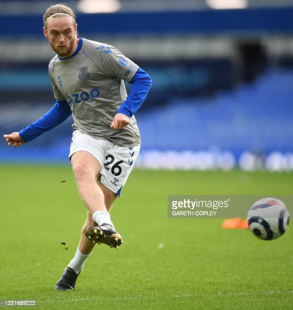 Everton's English midfielder Tom Davies warms up for the English Premier League football match between Everton and Burnley at Goodison Park in...