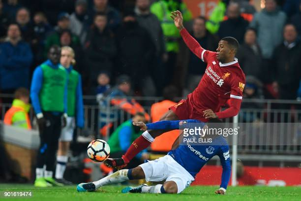 Everton's English striker Ademola Lookman tackles Liverpool's Dutch midfielder Georginio Wijnaldum during the English FA Cup third round football...