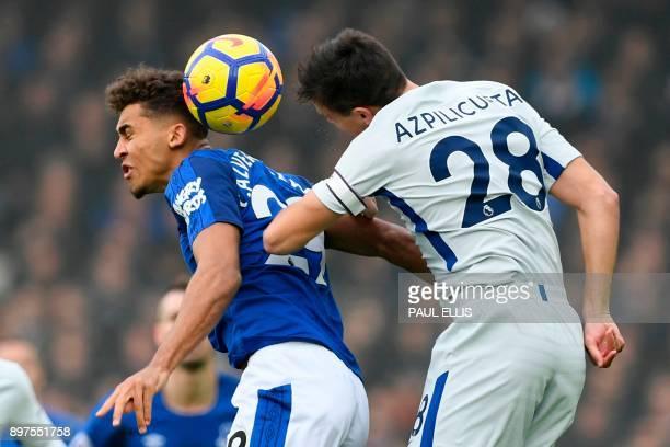 Everton's English striker Dominic Calvert-Lewin and Chelsea's Spanish defender Cesar Azpilicueta jump for the ball during the English Premier League...