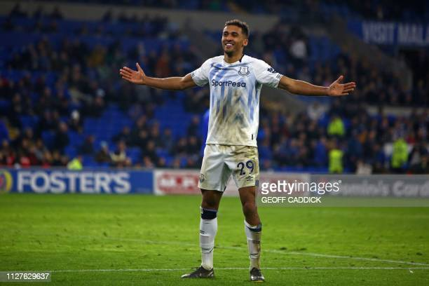 Everton's English striker Dominic CalvertLewin celebrates after scoring their third goal during the English Premier League football match between...