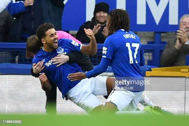 Everton's English striker Dominic CalvertLewin celebrates with teammates after scoring their second goal during the English Premier League football...