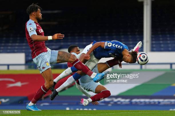 Everton's English striker Dominic Calvert-Lewin dives for a header during the English Premier League football match between Everton and Aston Villa...