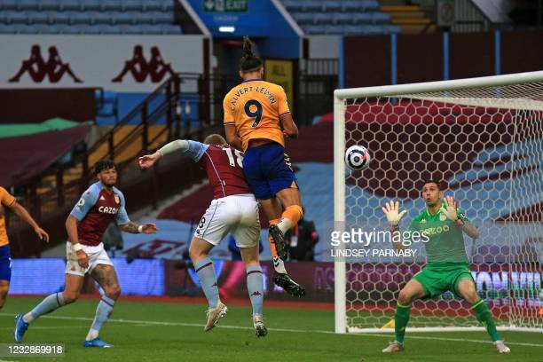 Everton's English striker Dominic Calvert-Lewin has this header saved during the English Premier League football match between Aston Villa and...