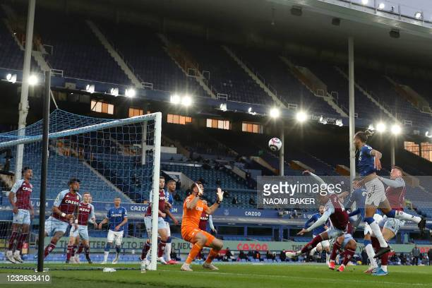 Everton's English striker Dominic Calvert-Lewin heads home their first goal during the English Premier League football match between Everton and...