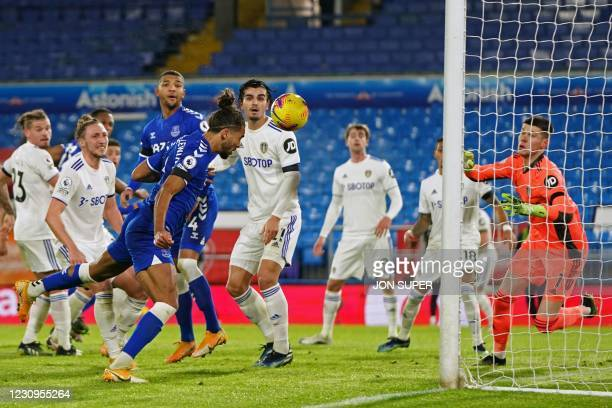 Everton's English striker Dominic Calvert-Lewin heads home their second goal during the English Premier League football match between Leeds United...