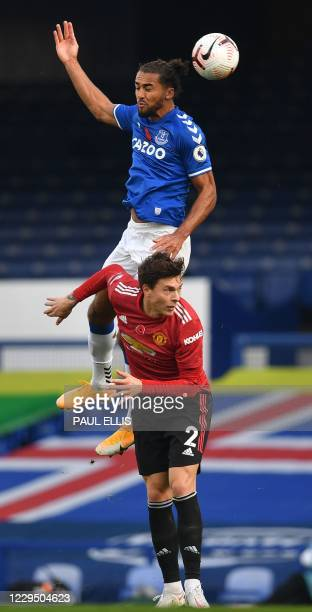 Everton's English striker Dominic Calvert-Lewin jumps above Manchester United's Swedish defender Victor Lindelof during the English Premier League...
