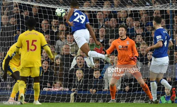 Everton's English striker Dominic Calvert-Lewin jumps to head home the opening goal past Crystal Palace's Welsh goalkeeper Wayne Hennessey during the...