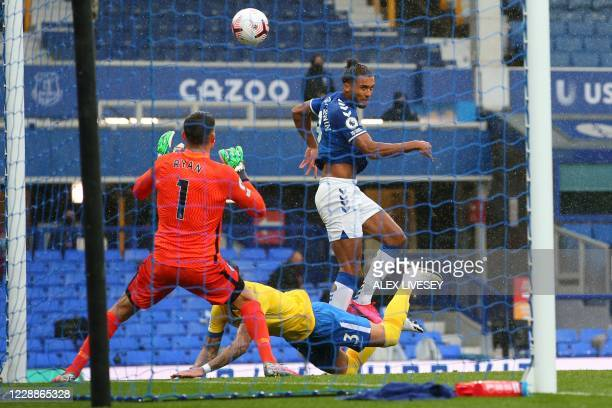 Everton's English striker Dominic Calvert-Lewin jumps to head home the opening goal of the English Premier League football match between Everton and...