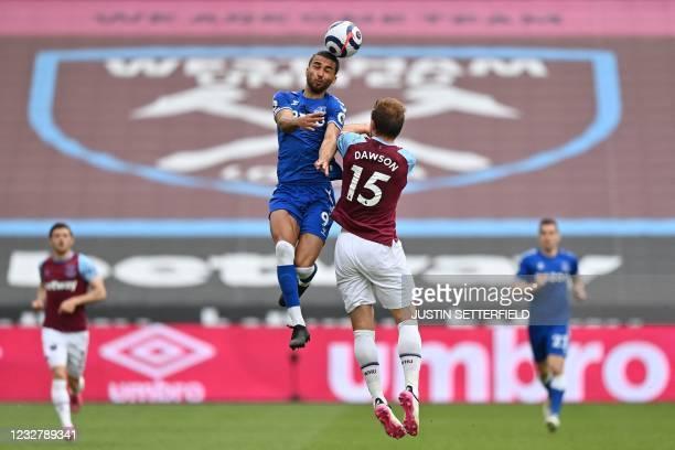 Everton's English striker Dominic Calvert-Lewin jumps to head the ball against West Ham United's English defender Craig Dawson during the English...