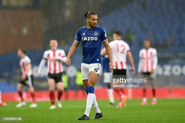 Everton's English striker Dominic Calvert-Lewin looks on in the rain during the English Premier League football match between Everton and Sheffield...