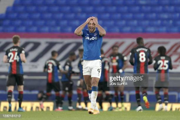 Everton's English striker Dominic Calvert-Lewin reacts after Palace scored during the English Premier League football match between Everton and...