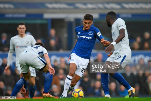 Everton's English striker Dominic CalvertLewin runs through and takes on Chelsea's Spanish defender Cesar Azpilicueta and Chelsea's German defender...