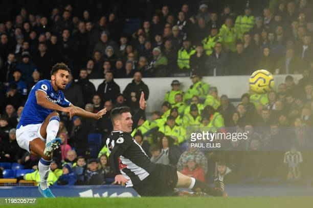 Everton's English striker Dominic CalvertLewin scores his team's second goal past Newcastle United's Irish defender Ciaran Clark during the English...