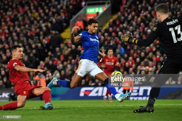 Everton's English striker Dominic CalvertLewin shoots but fails to score during the English Premier League football match between Liverpool and...