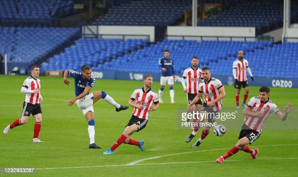 Everton's English striker Dominic Calvert-Lewin shoots but fails to score during the English Premier League football match between Everton and...