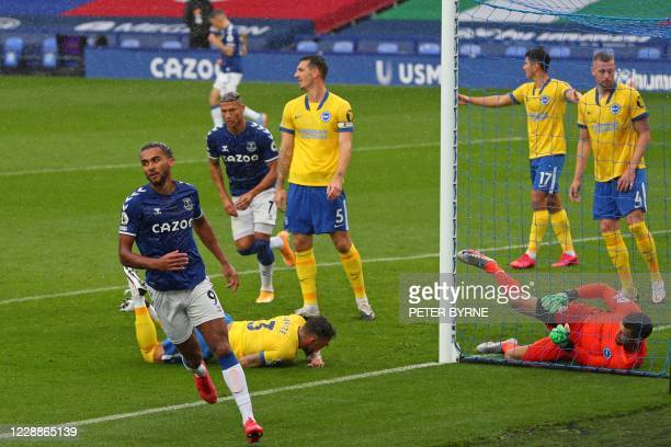 Everton's English striker Dominic Calvert-Lewin turns to celebrate after scoring the opening goal of the English Premier League football match...